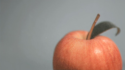 Red apple in super slow motion being wet Footage