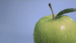 Downpour in super slow motion falling on an apple Footage