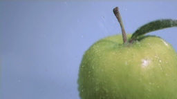 Downpour in super slow motion falling on an apple Stock Video Footage