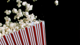 Box of popcorn in super slow motion falling Stock Video Footage