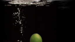 Lime in super slow motion dropping Stock Video Footage