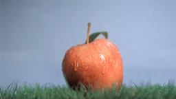 Apple in super slow motion placed under the rain Stock Video Footage