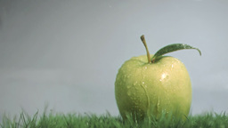 Raindrops in super slow motion falling on an apple Footage