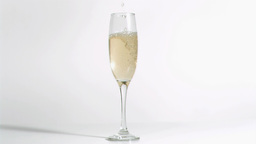Sparkling wine in super slow motion filling a glas Footage