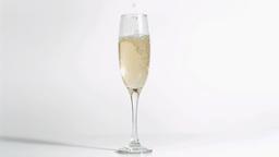 Sparkling wine in super slow motion filling a glas Footage