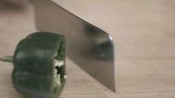 Cleaver in super slow motion cutting a pepper Footage