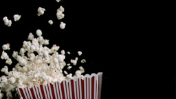Popcorn in super slow motion being spilled Footage