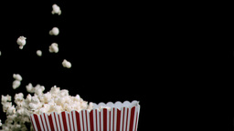 Popcorn in super slow motion being spilled Stock Video Footage