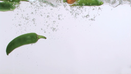 Green peppers in super slow motion being wet Stock Video Footage