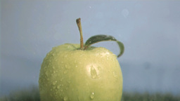 Green apple in super slow motion getting wet Footage