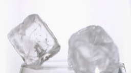 Ice cubes in super slow motion falling together Footage