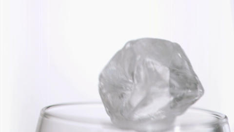 Ice cubes in super slow motion falling together Stock Video Footage