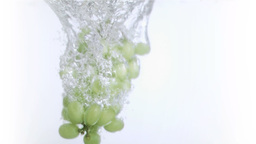 Grapes in super slow motion falling in the water Footage