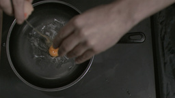 Egg in super slow motion being placed in a pan Stock Video Footage
