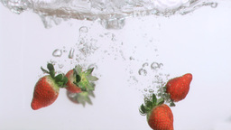 Delicious strawberries in super slow motion fallin Footage