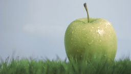 Water in super slow motion dripping on an apple Footage