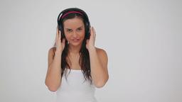 Happy brunette woman wearing headphones Footage