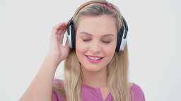 Happy blonde woman listening to music Footage