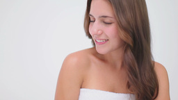 Smiling brunette woman massaging her shoulder Stock Video Footage