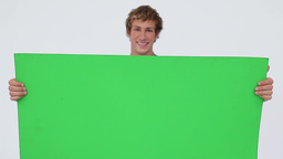 Cheerful man holding a blank poster Stock Video Footage