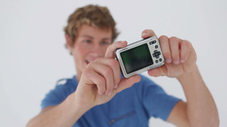 Smiling young man photographing himself Stock Video Footage