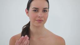 Happy brunette woman massaging her cheek Stock Video Footage