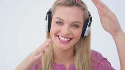 Blonde woman dancing while listening to music Footage
