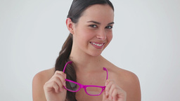 Smiling woman wearing pink glasses while laughing Footage