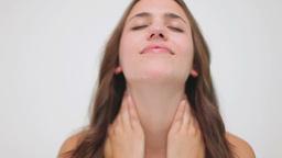 Happy brunette woman massaging her neck Footage