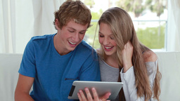 Couple looking at an ebook together Stock Video Footage