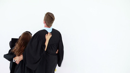 Cheerful graduated students hugging each other Stock Video Footage
