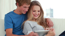 Happy couple using a tablet computer Footage