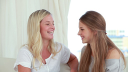 Happy young women talking to each other Stock Video Footage