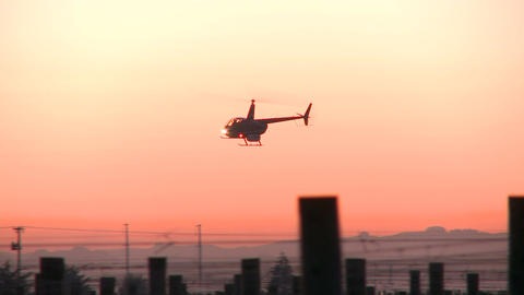 two helicopters in sunrise sky Footage