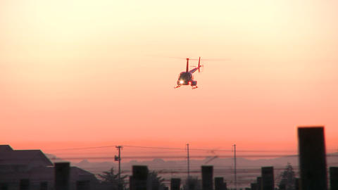 two helicopters in sunrise sky Stock Video Footage