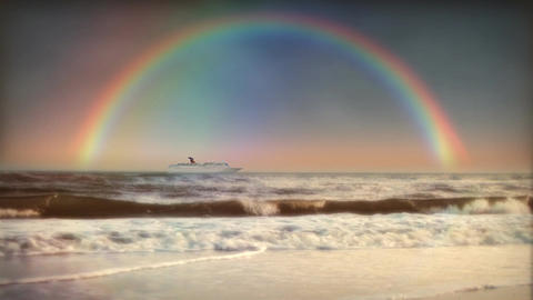 (1200) Full Rainbow Sky Ocean Surf Waves Beach Sunset... Stock Video Footage