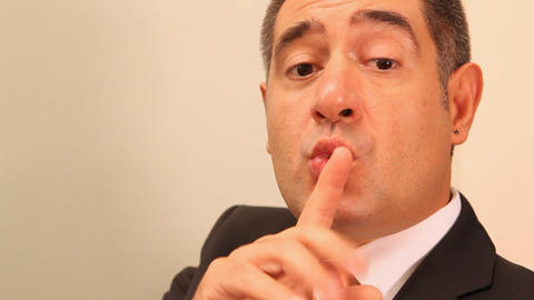 Businessman with finger on lips Stock Video Footage