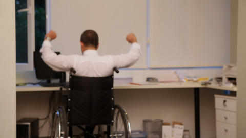 businessman concept lifestyle hanSuccessful businessman with wheelchair Footage