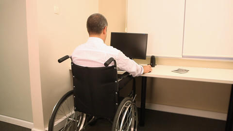 Successful businessman with wheelchair Stock Video Footage
