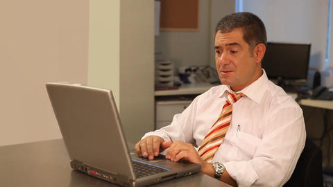 Businessman working hard on laptop in office Stock Video Footage