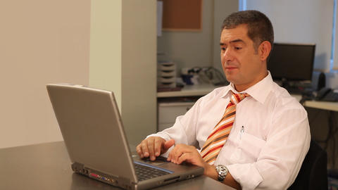 Businessman working hard on laptop in office Footage