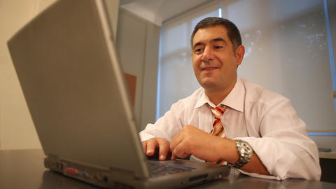 Successful businessman working on laptop in office Stock Video Footage