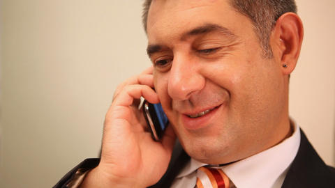 Businessman using mobile phone, smiling - Chatting Footage