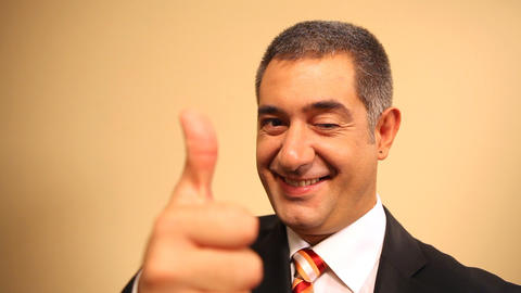Successful businessman giving thumbs up - Achievement Live Action