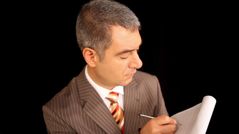 Businessman writing on notepad Footage