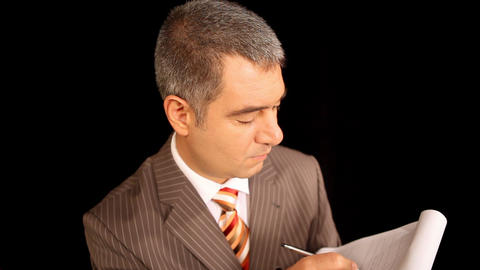 Businessman writing on notepad Stock Video Footage