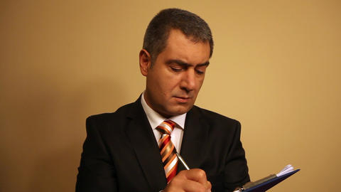 Businessman writing document on clipboard Footage