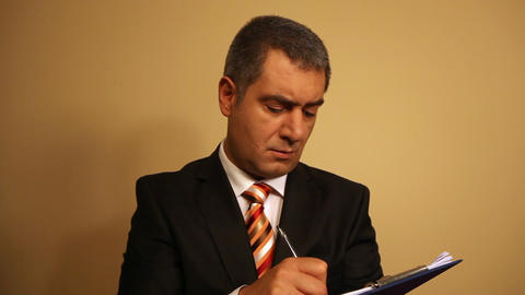 Businessman writing document on clipboard Stock Video Footage