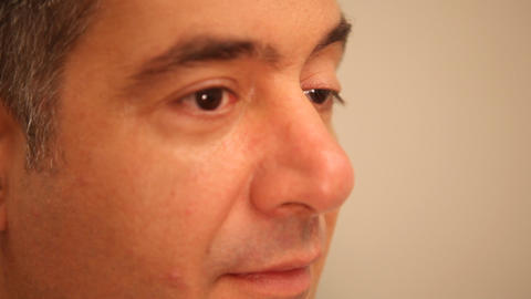 Mans face with eyes moving, close-up Stock Video Footage