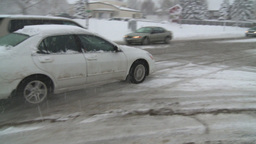 HD2008-12-7-12 snow traffic spinning tires Stock Video Footage